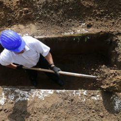 Gravedigger competes in Hungarian grave digging championship in Debrecen