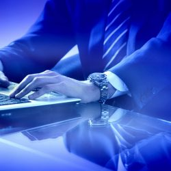 businessman_hands_keyboard_laptop